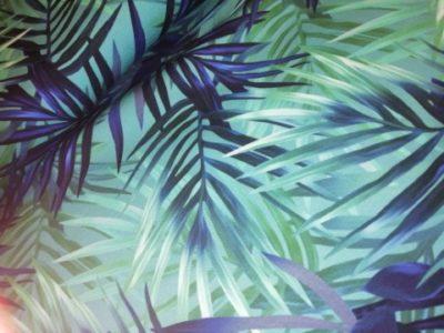 Stenzo tricot met digitale print van palmbladeren in blauw en groen tintenatoenen tricot palmbladeren blauw groen